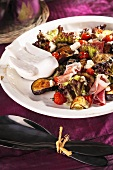 Aubergine salad with raw ham and cherry tomatoes