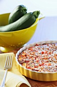 Courgette and tomato tart with pine nuts
