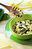 Courgette salad in green bowl