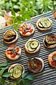Assorted mini-pizzas topped with summer vegetables