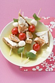 Tomato, mozzarella and turkey skewers