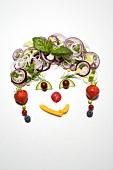 Gesicht aus Gemüse und Obst