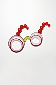 Spectacles made from onion rings and redcurrants