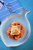 Sardine pasty (puff pastry) on tomato sauce