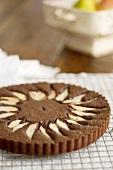 Chocolate cake with pears on cake rack