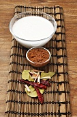 Coconut milk and spices on bamboo mat (Thailand)