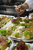 Assorted canapes on silver platters
