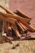 Several cinnamon sticks and cloves