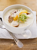 Cream of root vegetable soup with sausages