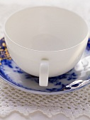 White soup cup with blue and white saucer