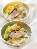 Roast rabbit loin with root vegetables on green sauce