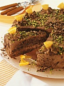 Chocolate cake with pistachios and pieces of orange