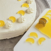 Decorating cream cake with jelly figures