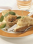 Baked chicken breast with herb stuffing on toast