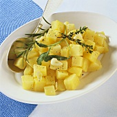 Herb potatoes with garlic cooked in Römertopf