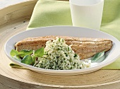 Fried brook trout fillet with herb rice