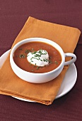 Creamed tomato soup with cream and chives