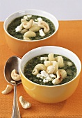 Spinach and pasta stew with cashew nuts and feta