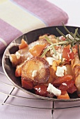 Mediterranean pan-cooked potato dish with peppers and feta