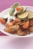 Fried potatoes with courgettes, tomatoes and sour cream