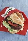 Steak sandwich with tomatoes and cucumber