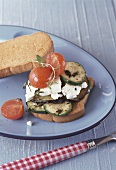 Zwieback (rusk) with roasted vegetables and feta