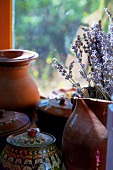 Terracotta containers and lavender by window