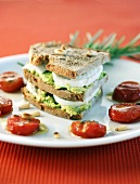 Triple-decker avocado & mozzarella sandwich in toasted wood oven bread