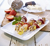 Fruit skewers with chocolate drizzle and grated coconut