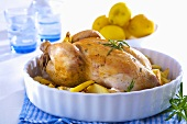 Stuffed chicken with rosemary, potatoes and lemons