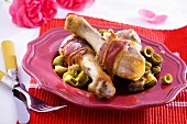 Ham-wrapped chicken drumsticks with olives
