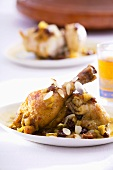 Chicken legs with almonds, raisins and onions (North Africa)