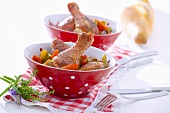 Chicken legs marinated in red wine with carrots and celery