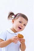 Little girl holding muffin