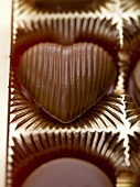 Heart-shaped chocolate in packaging (close-up)