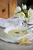 Camembert soup with baguette slices