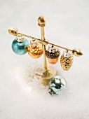 Christmas tree ornaments hanging on stand