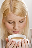 Blond woman drinking tea