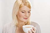 Blond woman with cup of tea