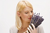 Blond woman holding bunch of lavender
