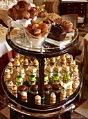 Assorted cakes and fancies on elegant tiered stand