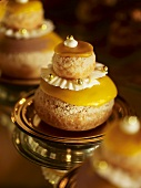 Almond macaroons with yellow icing and gold dragees
