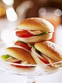 Small turkey sandwiches in glass pedestal dish