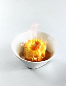 Langres (soft French cheese) flambéed in Armagnac