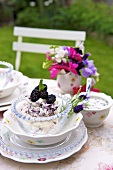 Blackberry dessert with meringue on garden table