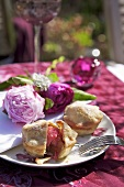 Rhubarb pies on plate with peonies