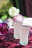 Two glasses of rhubarb vodka