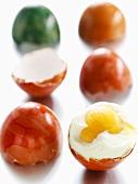 Coloured boiled eggs, broken open