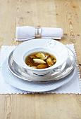 Clear cep soup with polenta dumplings