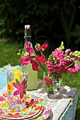 Lemonade and flowers on picnic basket